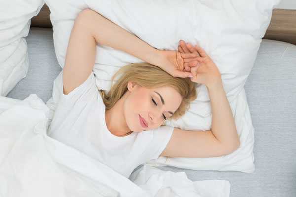 Young Beautiful Woman Sleeping With Pillow In Bed